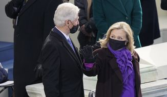 Former President Bill Clinton and former Secretary of State Hillary Clinton arrive for the 59th Presidential Inauguration at the U.S. Capitol in Washington, Wednesday, Jan. 20, 2021. (AP Photo/Carolyn Kaster)