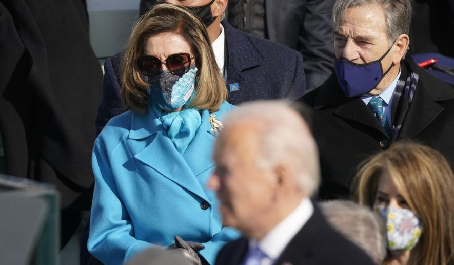 House Speaker Nancy Pelosi of Calif., listens as President Joe Biden delivers his inaugural address after being sworn in at the 46th president of the United State during the 59th Presidential Inauguration at the U.S. Capitol in Washington, Wednesday, Jan. 20, 2021. (AP Photo/Andrew Harnik)