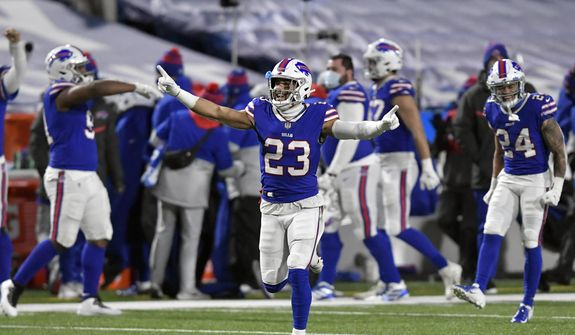 Buffalo Bills' Micah Hyde (23) celebrates with teammates after an NFL divisional round football game against the Baltimore Ravens Saturday, Jan. 16, 2021, in Orchard Park, N.Y. The Bills won 17-3. (AP Photo/Adrian Kraus) **FILE**