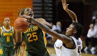 Oklahoma State forward Natasha Mack (4) knocks the ball away from Baylor center Queen Egbo (25) during the first half of an NCAA college basketball game Wednesday, Jan. 20, 2021, in Stillwater, Okla. (AP Photo/Sue Ogrocki)