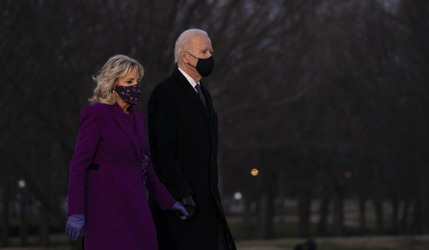 President-elect Joe Biden and his wife Jill Biden arrive for a COVID-19 memorial event at the Lincoln Memorial Reflecting Pool, Tuesday, Jan. 19, 2021, in Washington. (AP Photo/Evan Vucci)