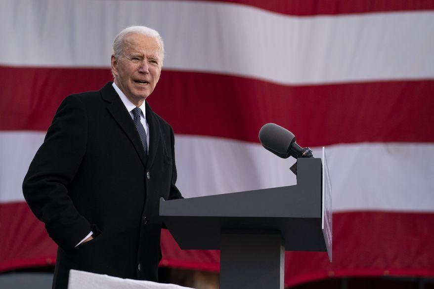 "President-elect Joe Biden speaks at the Major Joseph R. ""Beau"" Biden III National Guard/Reserve Center, Tuesday, Jan. 19, 2021, in New Castle, Del. (AP Photo/Evan Vucci)"