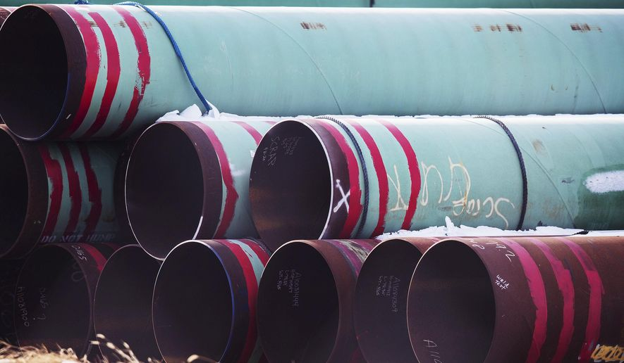 In this Dec. 18, 2020 photo, pipes to be used for the Keystone XL pipeline are stored in a field near Dorchester, Neb. Canadian Prime Minister Justin Trudeau says his officials have been in frequent contact with President-elect Joe Biden's incoming administration making the case for a long disputed oil pipeline that reports say Biden will cancel on his first day in office.   (Chris Machian /Omaha World-Herald via AP)