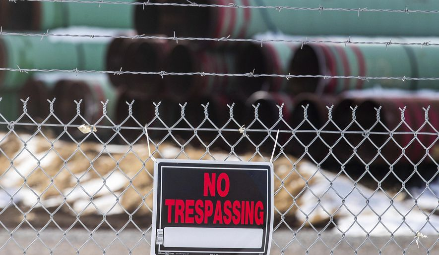 In this Dec. 18, 2020, file photo, pipes to be used for the Keystone XL pipeline are stored in a field near Dorchester, Neb. (Chris Machian /Omaha World-Herald via AP) ** FILE **