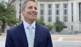 FILE - In this May 2, 2019 file photo, former Alabama legislator Ed Henry smiles as he speaks with reporters  outside the federal courthouse in Montgomery, Ala.   President Donald Trump has pardoned the Alabama lawmaker who pleaded guilty two years ago for his role in a health care fraud case.  (AP Photo/Kim Chandler, File)