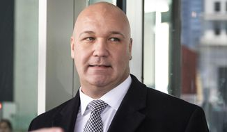 FILE - In this March 4, 2020 file photo, Casey Urlacher walks out of the Dirksen Federal Courthouse, in Chicago. Urlacher, mayor of the tiny Chicago suburb of Mettawa and brother of Chicago Bears Hall of Fame linebacker Brian Urbacher, received a pardon by President Donald Trump, Wednesday, Jan. 20, 2020, for pending federal charges that he recruited for a multi-million dollar illegal offshore gambling ring. (Ashlee Rezin Garcia/Chicago Sun-Times via AP)