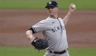 FILE - In this Oct. 6, 2020, file photo, New York Yankees pitcher J.A. Happ throws to a Tampa Bay Rays batter during the second inning in Game 2 of a baseball American League Division Series in San Diego. The Minnesota Twins and Happ agreed Wednesday, Jan. 20, to a one-year, $8 million contract, according to a person with knowledge of the deal. The person confirmed the agreement to The Associated Press, speaking on condition of anonymity because the team had not announced it. (AP Photo/Gregory Bull, File)