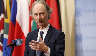 FILE - In this April 30, 2019 file photo, U.N. Special Envoy for Syria Geir Pedersen speaks to journalists following a U.N. Security Council meeting on Syria at U.N. headquarter. Pedersen announced Wednesday, Jan. 20, 2021,  that the next round of talks toward revising the war-battered country's constitution will start in Geneva on Jan. 25 and urged the parties to move to actual drafting.  (AP Photo/Kathy Willens, File)