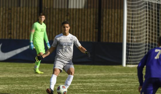 Georgetown center back Rio Hope-Gund sets himself to pass the ball. (Courtesy Georgetown Athletics Communications)