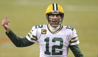 Green Bay Packers quarterback Aaron Rodgers (12) in action during the first half of an NFL football game against the Chicago Bears, Sunday, Jan. 3, 2021, in Chicago. (AP Photo/Kamil Krzaczynski)