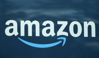 An Amazon logo appears on an Amazon delivery van, Thursday, Oct. 1, 2020, in Boston. Amazon won't be forced to restore web service to Parler after a federal judge ruled Thursday, Jan. 21, 2021, against a plea to reinstate the fast-growing social media app favored by followers of former President Donald Trump. (AP Photo/Steven Senne, file)