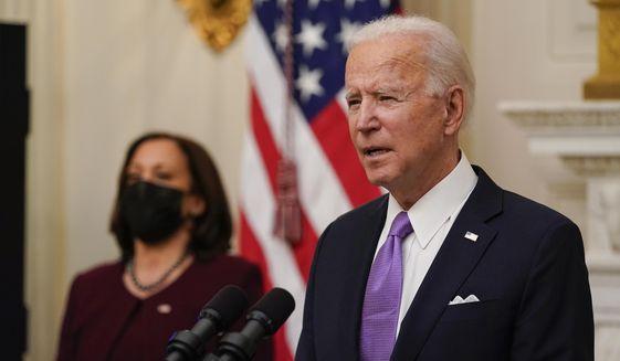 President Joe Biden speaks about the coronavirus, accompanied by Vice President Kamala Harris, in the State Dining Room of the White House, Thursday, Jan. 21, 2021, in Washington. (AP Photo/Alex Brandon) ** FILE **