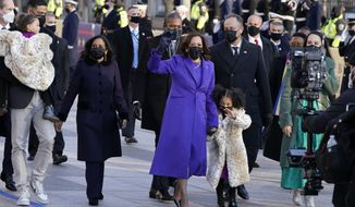 Vice President Kamala Harris, and her husband Doug Emhoff, and family, walk in front of the White House during a Presidential Escort to the White House, Wednesday, Jan. 20, 2021 in Washington, after being sworn in as the 46th vice president of the United States. (AP Photo/Jacquelyn Martin)