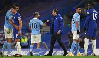 Manchester City's Sergio Aguero greets Chelsea's head coach Frank Lampard after the English Premier League soccer match between Chelsea and Manchester City at Stamford Bridge, London, England, Sunday, Jan. 3, 2021. City won the match 3-1. (AP Photo/Ian Walton/Pool)