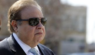 FILE - In this April 2, 2015 file photo, Dr. Salomon Melgen arrives at the Martin Luther King Jr. Federal Courthouse for his arraignment in Newark, N.J. The prominent Florida eye doctor, convicted of defrauding Medicare out of $73 million, got out of prison early on Wednesday, Jan. 20, 2021, after former President Donald Trump commuted his sentence just hours before his term ended. (AP Photo/Julio Cortez, File)