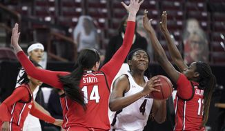 South Carolina forward Aliyah Boston (4) is defended by Georgia center Jenna Staiti (14) and guard Maya Caldwell (11) during the first half of an NCAA college basketball game Thursday, Jan. 21, 2021, in Columbia, S.C. (AP Photo/Sean Rayford)