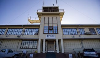 In this photo reviewed by U.S. military officials, the Office of Military Commissions building used for Periodic Review Board hearings is seen, Thursday, April 18, 2019, in Guantanamo Bay Naval Base, Cuba. The Pentagon has announced plans to move ahead with a military trial for three men held at the U.S. base at Guantanamo Bay, Cuba, who are suspected of involvement in bombings in Indonesia in 2002 and 2003. (AP Photo/Alex Brandon)