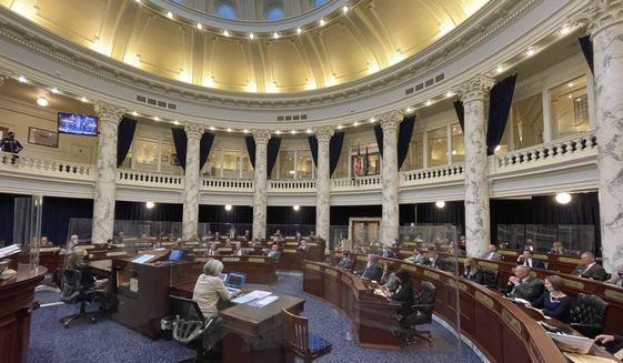 The Idaho House of Representatives debates a constitutional amendment in the Statehouse in Boise, Idaho, on Thursday, Jan. 21, 2021. A constitutional amendment allowing the part-time Idaho Legislature to call itself back into session has passed the House and is headed to the Senate. (AP Photo/Keith Ridler)