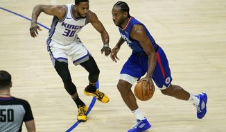 Sacramento Kings forward Glenn Robinson III (30) defends against Los Angeles Clippers forward Kawhi Leonard, right, during the first quarter of an NBA basketball game Wednesday, Jan. 20, 2021, in Los Angeles. (AP Photo/Ashley Landis)