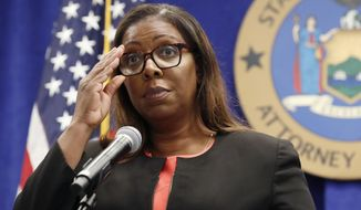In this Aug. 6, 2020, file photo, New York State Attorney General Letitia James adjusts her glasses as she announces that the state is suing the National Rifle Association during a press conference, in New York. A New York judge on Thursday, Jan. 21, 2021, denied the National Rifle Association's bid to throw out a state lawsuit that seeks to put the powerful gun advocacy group out of business. (AP Photo/Kathy Willens, File)