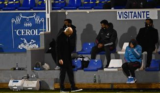 Real Madrid's head coach Zinedine Zidane reacts during a Spanish Copa del Rey round of 32 soccer match between Alcoyano and Real Madrid at the El Collao stadium in Alcoy, Spain, Wednesday Jan. 20, 2021. (AP Photo/Jose Breton)