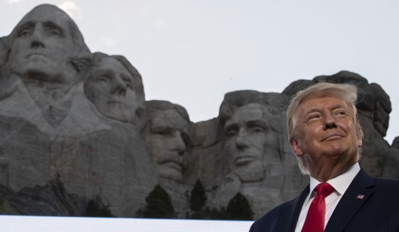 In this July 3, 2020, photo, President Donald Trump stands at Mount Rushmore National Memorial, near Keystone, S.D. South Dakota Gov. Kristi Noem says she gave former president Donald Trump a $1,100 bust depicting the president on Mount Rushmore last year because she knew it was something he wanted to receive. The gift was presented to Trump when he visited South Dakota on Friday, July 3, 2020 for an Independence Day fireworks celebration. (AP Photo/Alex Brandon) **FILE**