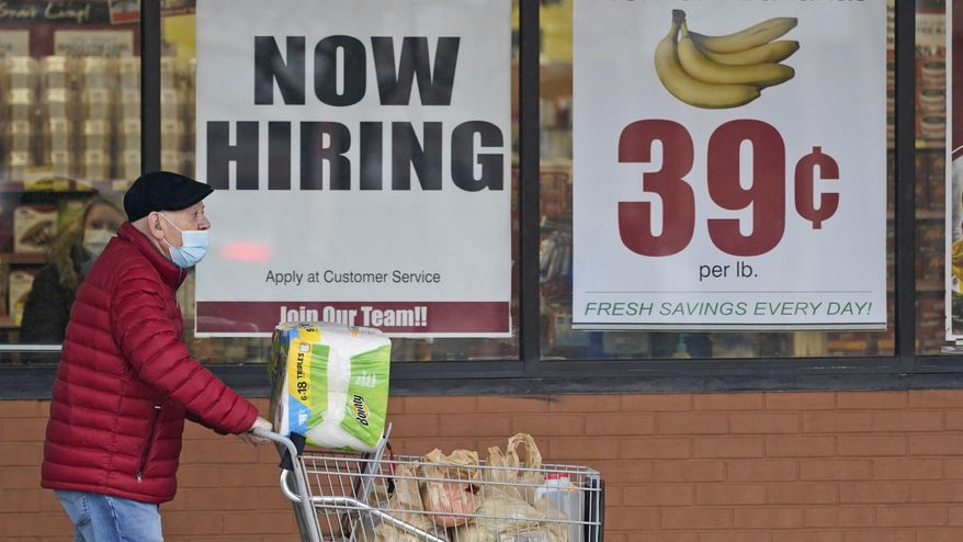 A man walks out of a Marc's Store, Friday, Jan. 8, 2021, in Mayfield Heights, Ohio. Fewer Americans applied for unemployment benefits last week, lowering claims to 900,000, still a historically high level that points to further job cuts in a raging pandemic. (AP Photo/Tony Dejak, file)