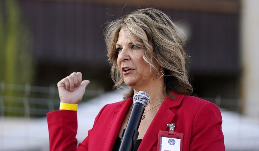 In this Nov. 18, 2020, file photo, Kelli Ward, chair of the Arizona Republican Party, holds a press conference in Phoenix. Ms. Ward won reelection as chairwoman of the state party on Jan. 23, 2021 after being endorsed by former President Donald Trump. (AP Photo/Ross D. Franklin, File)  **FILE**