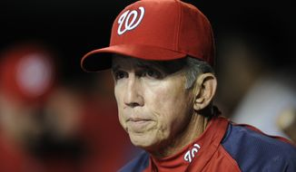 In this Aug. 7, 2013, file photo, Washington Nationals manager Davey Johnson watches from the dugout during the sixth inning of the team's baseball game against the Atlanta Braves in Washington. Johnson is in a Florida hospital with COVID-19, according to former New York Mets spokesman Jay Horwitz. Horwitz said he spoke with Johnson briefly on Friday. Johnson, 77, was a four-time All-Star second baseman and managed the Mets to their last World Series title in 1986. (AP Photo/Nick Wass, File) **FILE**