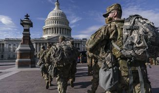 National Guard troops reinforce security around the U.S. Capitol ahead of expected protests leading up to President-elect Joe Biden's inauguration, in Washington, Sunday, Jan. 17, 2021, following the deadly attack on Congress by a mob of supporters of President Donald Trump. (AP Photo/J. Scott Applewhite)