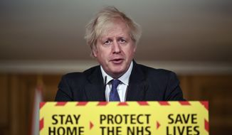 Britain's Prime Minister Boris Johnson speaks during a coronavirus press conference at 10 Downing Street in London, Friday, Jan. 22, 2021. Johnson announced that the new variant of COVID-19, which was first discovered in the south of England, may be linked with an increase in the mortality rate. (Leon Neal/Pool via AP)