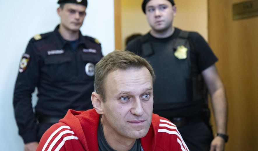 In this Aug. 22, 2019, file photo, Russian opposition leader Alexei Navalny speaks to the media prior to a court session in Moscow, Russia. The return of Navalny from Germany on Jan. 17, 2021, after he spent five months in Berlin recovering from a nerve agent poisoning was marked by chaos and popular outrage, and it ended, almost predictably with his arrest. (AP Photo/Alexander Zemlianichenko, File)