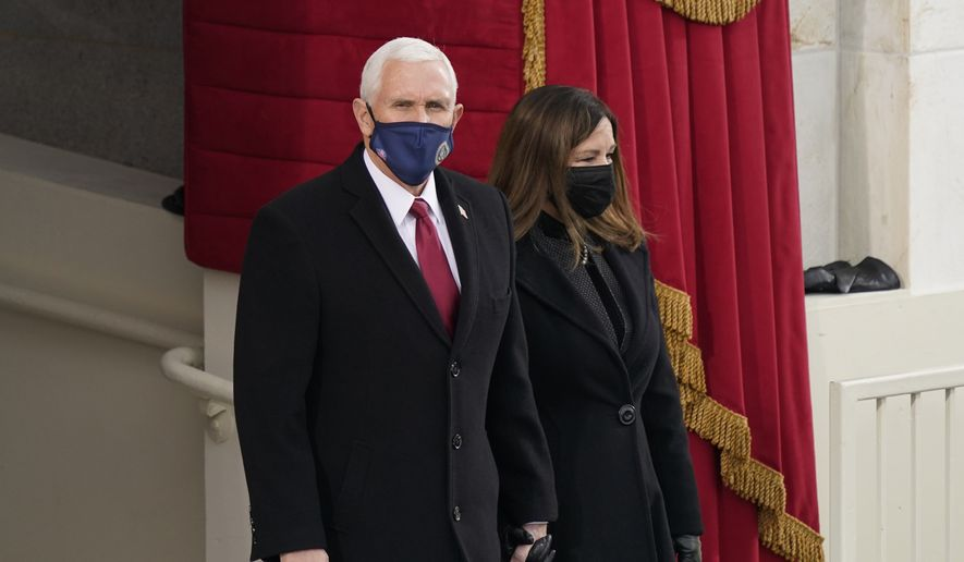 Vice President Mike Pence and his wife Karen, arrive for the 59th Presidential Inauguration at the U.S. Capitol for President-elect Joe Biden in Washington, Wednesday, Jan. 20, 2021. (AP Photo/Carolyn Kaster)  **FILE**
