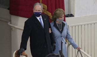Former President George W. Bush and his wife Laura arrive for the 59th Presidential Inauguration at the U.S. Capitol in Washington, Wednesday, Jan. 20, 2021. (AP Photo/Carolyn Kaster)