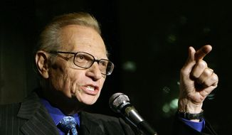In this April 18, 2007, file photo, Larry King speaks to guests at a party held by CNN, celebrating King's fifty years of broadcasting in New York. (AP Photo/Stuart Ramson, File)