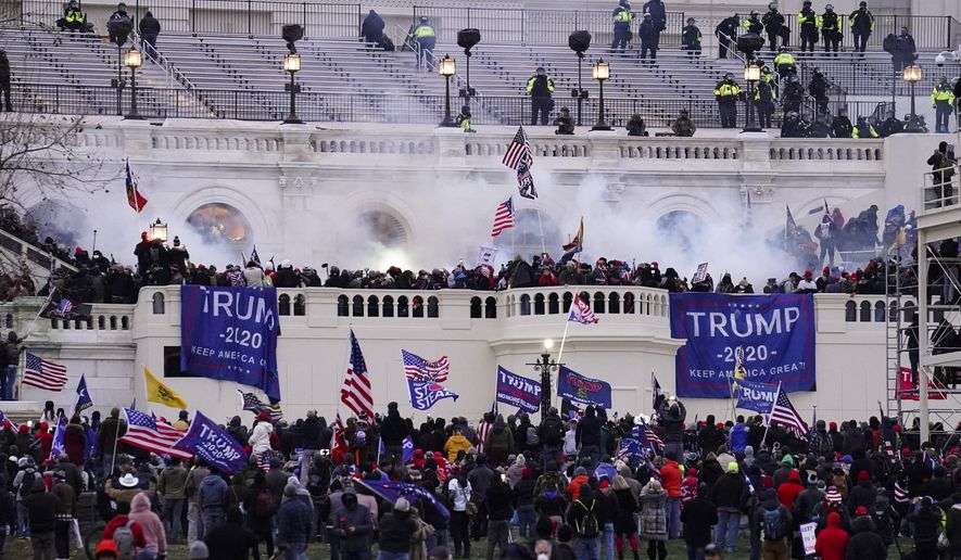 In this Jan. 6, 2021, file photo violent rioters, loyal to President Donald Trump, storm the Capitol in Washington. (AP Photo/John Minchillo, File)