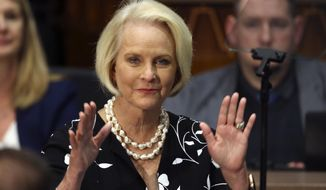 In this Jan. 13, 2020, photo Cindy McCain, wife of former Arizona Sen. John McCain, waves to the crowd after being acknowledged by Arizona Republican Gov. Doug Ducey during his State of the State address on the opening day of the legislative session at the Capitol in Phoenix. (AP Photo/Ross D. Franklin) **FILE**