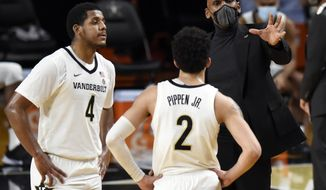 Vanderbilt head coach Jerry Stackhouse talks with guard's Jordan Wright (4) and Scotty Pippen Jr. (2) during the second half of an NCAA college basketball game against Arkansas, Saturday, Jan. 23, 2021, in Nashville, Tenn. Arkansas won 92-71. (AP Photo/Mark Zaleski)