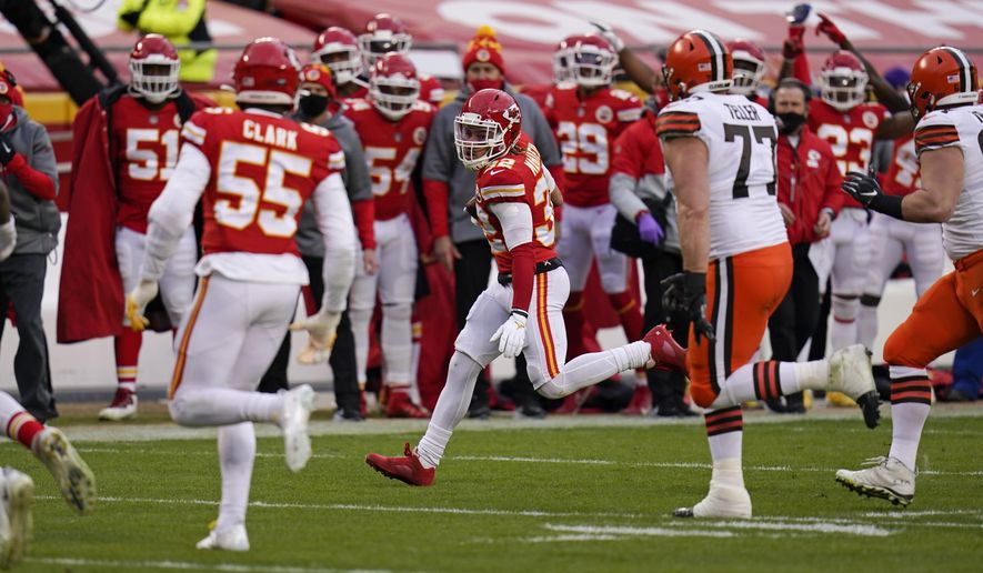 Kansas City Chiefs safety Tyrann Mathieu (32) returns an interception during the second half of an NFL divisional round football game against the Cleveland Browns, Sunday, Jan. 17, 2021, in Kansas City. (AP Photo/Jeff Roberson)