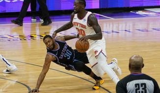 New York Knicks forward Julius Randle, right, is fouled by Sacramento Kings forward Glenn Robinson III, left, during the first quarter of an NBA basketball game in Sacramento, Calif., Friday, Jan. 22, 2021. (AP Photo/Rich Pedroncelli)