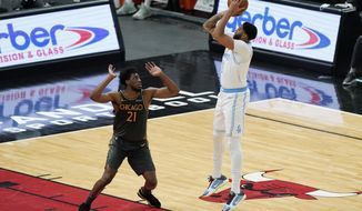 Los Angeles Lakers forward Anthony Davis, right, shoots against Chicago Bulls forward Thaddeus Young during the first half of an NBA basketball game in Chicago, Saturday, Jan. 23, 2021. (AP Photo/Nam Y. Huh)
