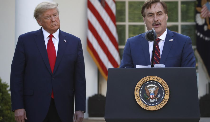In this March 30, 2020 file photo, MyPillow CEO Mike Lindell speaks as President Donald Trump listens during a briefing about the coronavirus in the Rose Garden of the White House, in Washington. (AP Photo/Alex Brandon, File)