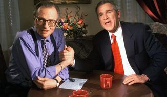 """FILE - In this Dec. 16, 1999 file photo, Republican presidential candidate Texas Gov. George W. Bush jokes with CNN's Larry King after finishing the """"Larry King Live"""" show from the Wildhorse Saloon in Nashville, Tenn.  King, who interviewed presidents, movie stars and ordinary Joes during a half-century in broadcasting, has died at age 87. Ora Media, the studio and network he co-founded, tweeted that King died Saturday, Jan. 23, 2021 morning at Cedars-Sinai Medical Center in Los Angeles.  (AP Photo/John Russell, file)"""
