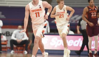 Syracuse guard Joseph Girard III (11) celebrates a basket against Virginia Tech  during an NCAA college basketball game at the Carrier Dome, Syracuse, N.Y., Saturday Jan. 23, 2021. (Scott Schild/The Post-Standard via AP)