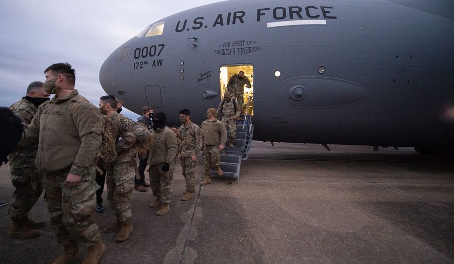 Governors called for National Guard troops to return home after they learned the troops were banished to a nearby parking garage after securing the U.S. Capitol for inauguration. (Associated Press)