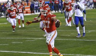 Kansas City Chiefs tight end Travis Kelce celebrates after catching a 5-yard touchdown pass during the second half of the AFC championship NFL football game against the Buffalo Bills, Sunday, Jan. 24, 2021, in Kansas City, Mo. (AP Photo/Reed Hoffmann) **FILE**