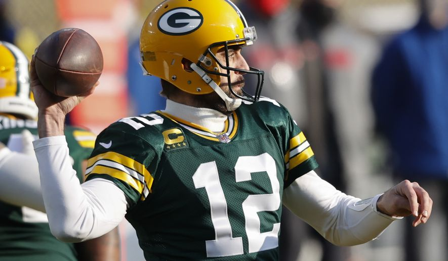 Green Bay Packers quarterback Aaron Rodgers passes during the first half of the NFC championship NFL football game against the Tampa Bay Buccaneers in Green Bay, Wis., Sunday, Jan. 24, 2021. (AP Photo/Jeffrey Phelps)