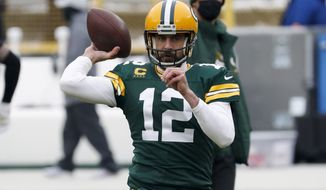 Green Bay Packers quarterback Aaron Rodgers warms up before the NFC championship NFL football game against the Tampa Bay Buccaneers in Green Bay, Wis., Sunday, Jan. 24, 2021. (AP Photo/Mike Roemer)
