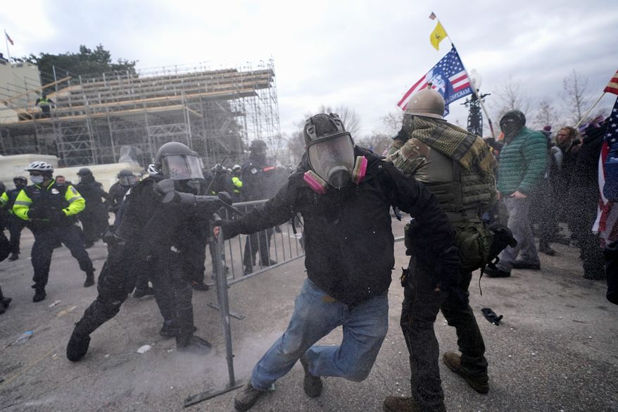 Trump supporters try to break through a police barrier, Wednesday, Jan. 6, 2021, at the Capitol in Washington. As Congress prepares to affirm President-elect Joe Biden's victory, thousands of people have gathered to show their support for President Donald Trump and his claims of election fraud. (AP Photo/Julio Cortez) **FILE**