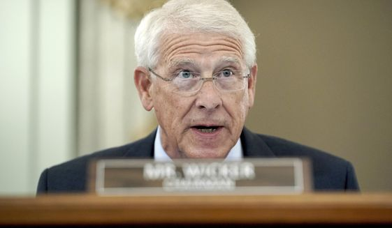 Sen. Roger Wicker, R-Miss., speaks during a hearing before the Senate Commerce Committee on Capitol Hill, Wednesday, Oct. 28, 2020, in Washington. The committee summoned the CEOs of Twitter, Facebook and Google to testify during the hearing. (Greg Nash/Pool via AP)